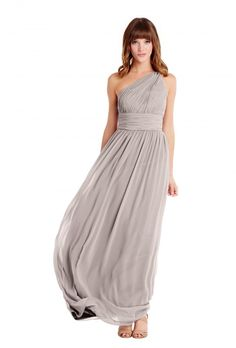 A rouched floor-length bridesmaid gown with a one shoulder design in five colors. . Affordable designer bridesmaid dresses to buy or rent at Vow To Be Chic.
