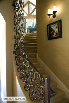 Stairs with wrought iron rail