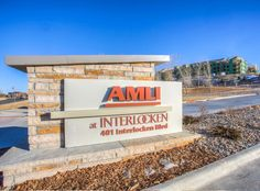AMLI Interlocken-Broomfield.  Ad Light + Sign's work like this monument sign enhanced the beauty of this community nestled among townships but with unbelievable nature scapes.