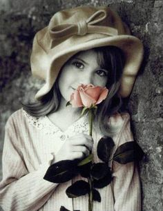 Pretty girl with a rose