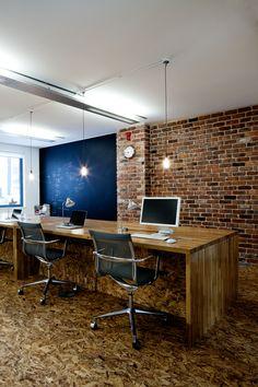 Creative Zone oak desks, blackboard and brick wall