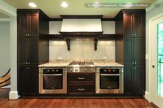 In some modern kitchen designs you'll see slightly raised single ovens set side by side, alone or with a warming drawer underneath.