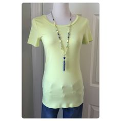 JCrew Perfect Fit Crewneck Tee Worn once. Color is Neon Aloe. Our superfine baby-rib cotton, cut a bit slimmer for a flattering fit. That's why we call it perfect. Cotton. Machine wash. 10% bundle discount no trades or pp. J. Crew Tops