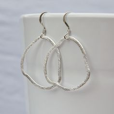 Sterling Silver Organic Hoop Earrings Freeform Textured Silver Hoops... ($28) ❤ liked on Polyvore featuring jewelry, earrings, long silver earrings, gold filled jewelry, silver jewellery, sterling silver hoop earrings and silver jewelry
