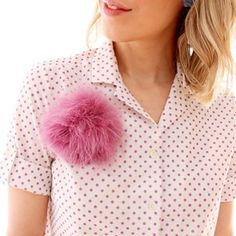 Add a fun splash of color to your ensemble with this easy DIY feather pouf!