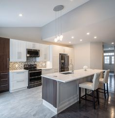 "Our Mainfloor Makeover ""passion project"" complete.  Featuring an open concept kitchen w/ quartz counter top, herringbone marble backsplash, 32""x32"" porcelain tile + many more cool features."