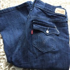 5082e493 Levi's 515 Bootcut Jeans - Dark Blue These dark blue Levi jeans are lightly  worn and