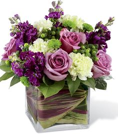 Wedding Flowers The Beloved Bouquet is a compact arrangement of green and purple flowers designed in a leaf lined square vase hand delivered by a local flower shop. Design Floral, Deco Floral, Beautiful Flower Arrangements, Silk Flowers, Beautiful Flowers, Flowers Vase, Green Flowers, Flowers Garden, Roses Vase