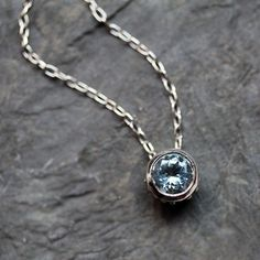 I had a necklace just like this, except it had a white diamond instead of a blue aquamarine solitaire bezel. I miss it :(