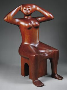 Elizabeth Catlett (American, born 1915) Woman Fixing Her Hair, 1993, Mahogany and opals.