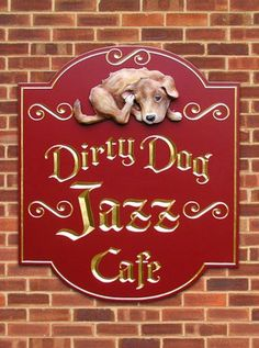 Dirty Dog Jazz Cafe - This one went to Michigan. Lettering is hand-carved  gilded. The dog is a sculpted artist-painted add-on. See more of our signs on www.danthoniadesigns.com