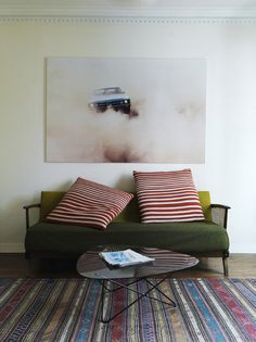Mmm Mid-Century Modern and huge striped pillows and a patterned rug