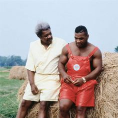 Amazing photo: Don King consoles Mike Tyson, in red leather overalls, sitting on a bale of hay
