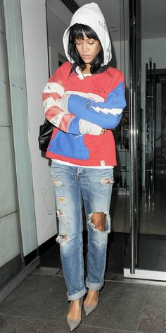 Rihanna paired her distressed denim with a Raif Adelberg sweatshirt, Stella McCartney backpack, and Christian Louboutin pumps for a pulled together yet relaxed look.