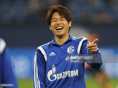 Atsuto Uchida of Schalke laughs during the warmup at the Bundesliga match between Schalke 04 and SC Freiburg at Veltins Arena on April 11 2015 in Gelsenkirchen Germany