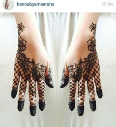 Arabic style Henna with dipped finger tips. Love the lace glove look of this design!