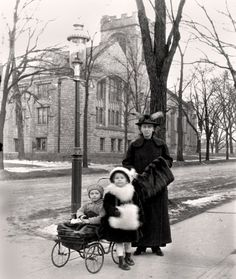 Hedwig Happel out for winter walk with daughter Johanna and son Hermann (in stroller) in Buffalo, N.Y., c. 1915. Their attire seems rather upscale. The family was never wealthy, but mechanical engineers at that time were in demand and paid well (similar to physicians today). One stroller wheel appears to have a chip out of the rubber. My online research leads me to believe that the building in the background is the Central Presbyterian Church. The church building was constructed in 1910 a...