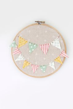 Cute baby's room gift. You could do the baby's name on the letters on the banner. 25 Exciting Embroidery Hoop Projects