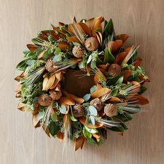 Made up of freshly cut seasonal plants, the Magnolia Wheat Wreath is artfully arranged to order. Magnolia leaves, pine cones and wheat give this arrangement a range of autumnal hues – and its fresh eucalyptus gives off a bright, energizing scent. Modern Christmas Decor, Christmas Diy, Christmas Wreaths, Christmas Design, Magnolia Wreath, Magnolia Leaves, Fall Door Decorations, Thanksgiving Decorations, Thanksgiving 2016