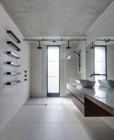 Bathroom in two-storey annex designed by Australian studio Nobbs Radford Architects.