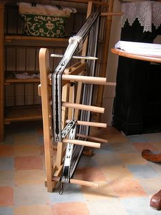 """Tablet weaving loom by brigittepicart, via Flickr. Repinned by Elizabeth VanBuskirk on """"Art & Weaving Teaching Ideas."""" A little belt loom like this would be wonderful to have in a classroom. But it is not necessary; card weaving can be done by attaching one end of the warp around your back, the other end  around a door nob. Or turn a table upside down and a number of kids can do the narrow bands as """"backstrap weaving."""""""
