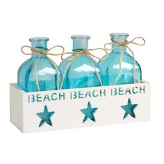 One of my favorite discoveries at ChristmasTreeShops.com: Encased Beach Bottle Decor Set