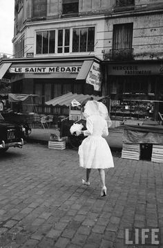Bride crossing a Parisian street. Paris, France, 1963   photo by Alfred Eisenstaedt