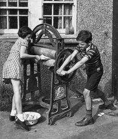Wash Day, 1940's style.  Two British children helping their mother with the wash.  It was often an all day job.