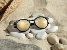 Gold baby, gold in summer ready Ray-Ban rounded shades that are made for summer.