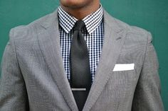 Gray suit and black checkered shirt