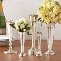 "Set of Five Silver Vases PlazaTM Set of 5 Vases - Lacquered Silver Plated Brass. By Twos Company.Dimensions (in):2"""" x 5 1/4"""" H, 2 1/4"""" x 5 1/2"""" H, 3"""" x 7 1/2"""" H, 3 1/2""""By Twos Company - Twos Co"