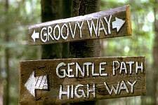 Woodstock Festival '69. Bethel, New York.  Signposts help festival goers find their way.  ©Tom Miner/The Image Works