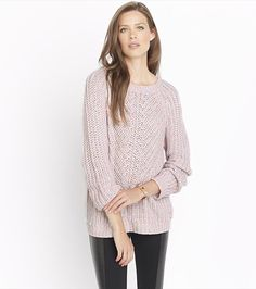Wear this light pink sweater over one of our button up blouses with a pair of faux leather leggings for the perfect transitioning look.