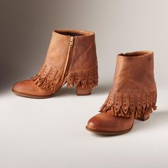 """UNCHARTED TERRITORY BOOTS--A whole new take on Western chic with luxe, burnished leather and intricate, textured fringe in a spats-inspired silhouette. Leather. Imported. Exclusive. Euro whole sizes 36 to 41. 36 (US 7), 37 (US 7.5), 38 (US 8.5), 39 (US 9.5), 40 (US 10), 41 (US 10.5). 3"""" heel."""