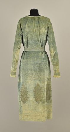 FORTUNY STENCILED VELVET TUNIC with BELT and PURSE, Seafoam green having a repeating stenciled metallic gold pattern with bands to the long sleeves and belt, slit neckline with rolled and printed binding and silk cord laces with Murano glass beads at the tips, tissue silk lining.