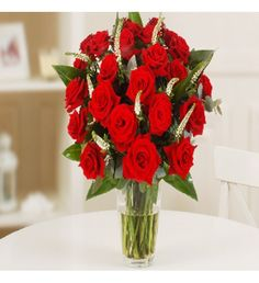 This bouquet will send your message of love and devotion in the language of flowers. This is a truly magnificent bouquet of 20 stunning deep red Grand Prix roses arranged with elegant spikes of white Veronica and pretty foliage.