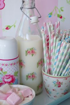 love the milk bottle! I might try this using vintage floral decals from etsy and my ikea water bottles.