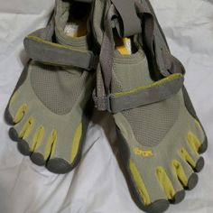 Vibram Fivefingers Barefoot Five Finger Toe Shoes Never worn, brand new. Gray/blue and yellow/green. Vibram Shoes Athletic Shoes