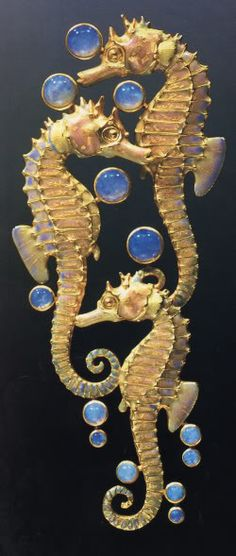 René Lalique. 1902-03 Three Seahorses Brooch. Chased gold/ plique-à-jour enamel/ opals