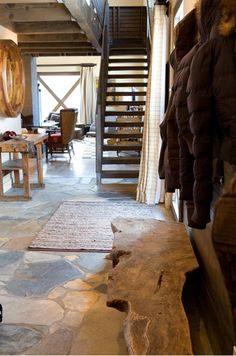 rustic cabin entryway, salvaged work bench, stone floors, live edge bench.