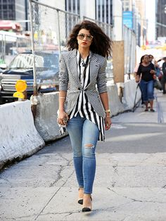 NYFW Street Style Spring 2016 - Nina Tiari's black and white top and blazer with jeans, pumps, sunglasses and red lipstick | allure.com