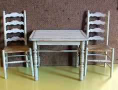 Miniature Shabby Off White Table and 2 Chairs (1 inch dollhouse scale). $60.00, via Etsy.