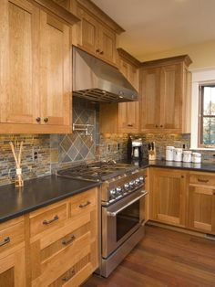Use a different tile pattern behind the stove than what is used for the rest of the backsplash...