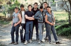 Tom Cruise, Rob Lowe C. Thomas Howell, Ralph Macchio, Matt Dillon, Emilio Estevez, and Patrick Swayze in The Outsiders (1983)