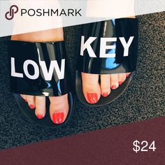 Low Key Slides Black patent slides with white print. Definite low 🔑 vibes, perfect for summer! Man made materials. Only whole sizes available. If you're a half size, I recommend sizing down. Runs true to size! Boutique Shoes Sandals