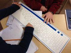 Children practice their math skills through the math board at Thevenet Montessori School.