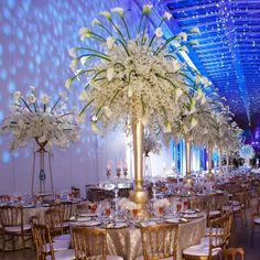 A dreamlike winter wedding celebration at the Art Institute of Chicago with vibrant lighting design. (via Bob & Dawn Davis Photography)