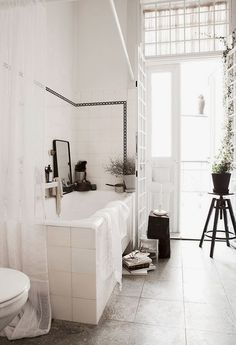 A romantic old school bathroom with a modern twist
