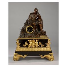 """Lord Byron"", first half of 19th Century.  Gilt bronze mantel clock depicting Lord Byron sitted on ruins. He is dressed in a English costume carrying his pistol and sword.  Dimensions: 83Χ66Χ28 cm."