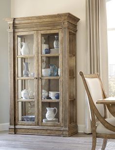 Furniture Pavilion Curio China Cabinet Seeded Gl Crown Molding And A Warmly Hued Finish Lend Casual Elegance To